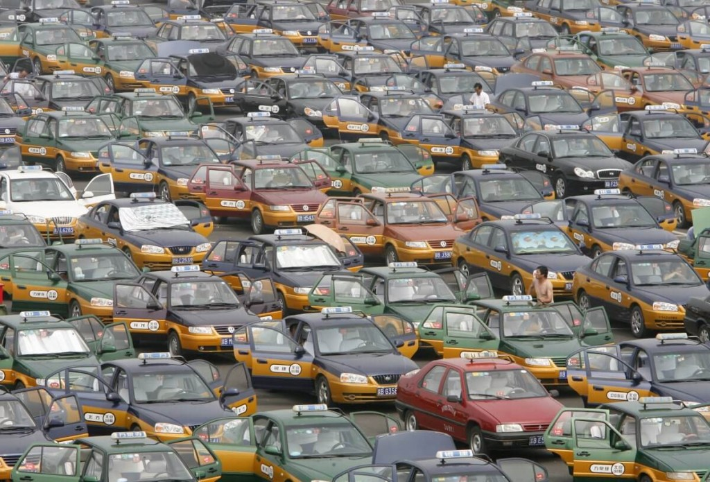 taxi-drivers-line-up-in-a-parking-lot-while-waiting-for-passengers-at-the-new-beijing-capital-international-airport (1)