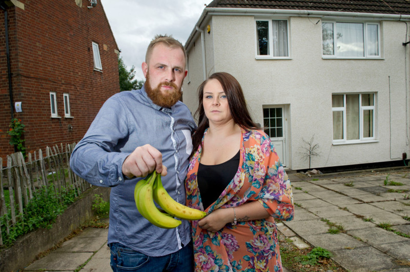Ashley Gamble, 28,and his partner Sophia, who have fled from their home with their two children, including a three week old daughter, after it was invaded by around 150 of the most deadly spiders in the world who arrived on a banana from Asda and hatched out in their kitchen (NOT IN THE BANANAS SHOWN HERE). The family were advised to move out by a pest control company and are living at Ashley's parents house. See story by Andrew Parker.